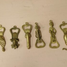 Brass bottle opener with figurines